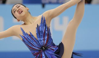 Mao Asada of Japan competes in the women's free skate figure skating finals at the Iceberg Skating Palace during the 2014 Winter Olympics, Thursday, Feb. 20, 2014, in Sochi, Russia. (AP Photo/Bernat Armangue)