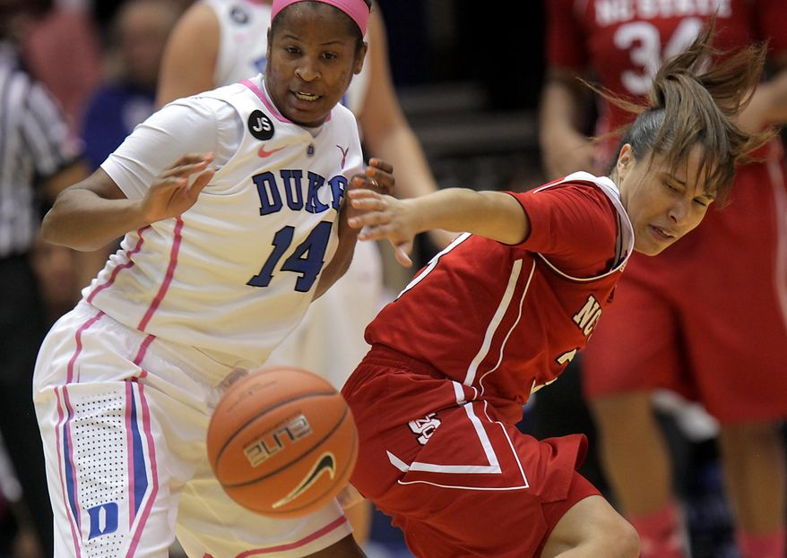 Duke's Ka'lia Johnson (14) battles for a loose ball with NC State's Miah Spencer, right, during the first half of an NCAA college basketball game in Durham, N.C., Thursday, Feb. 20, 2014.  (AP Photo/Ted Richardson)