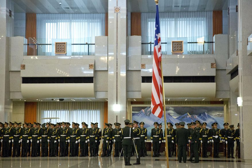 Chinese People's Liberation Army honor guard members wait to rehearse before a welcome ceremony for the visiting U.S. Army Chief of Staff Gen. Raymond Odierno at China's Ministry of Defense in Beijing, Friday, Feb. 21, 2014. (AP Photo/Alexander F. Yuan, Pool)