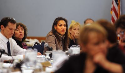 University of Michigan Board of Regents member Shauna Ryder Diggs, center, and other members of the board listen during a meeting Thursday, February 20 at the Michigan Union in Ann Arbor, Mich. (AP Photo/The Ann Arbor News, Brianne Bowen)