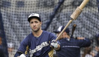 In this April 24, 2013, photo, Milwaukee Brewers' Ryan Braun swings a weighted bat outside the batting cage before the Brewers' baseball game against the San Diego Padres in San Diego. Braun has returned from suspension to a new position with the Brewers. It was the first day back for the 2011 NL MVP since being suspended for 65 games in 2013 for violating Major League Baseball's anti-drug agreement. Braun faced familiar questions and delivered familiar answers. He said he took responsibility. He's ready to move on. He's transitioning from left to right field this year. (AP photo/Lenny Ignelzi)