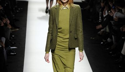 A model wears a creation for Max Mara women's Fall-Winter 2014-15 collection, part of the Milan Fashion Week, unveiled in Milan, Italy, Thursday, Feb. 20, 2014. (AP Photo/Giuseppe Aresu)