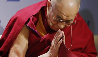 "**FILE** Tibetan spiritual leader the Dalai Lama acknowledges the audience before speaking at an event entitled: ""Happiness, Free Enterprise, and Human Flourishing"" Thursday, Feb. 20, 2014, at the American Enterprise Institute in Washington. (Associated Press)"