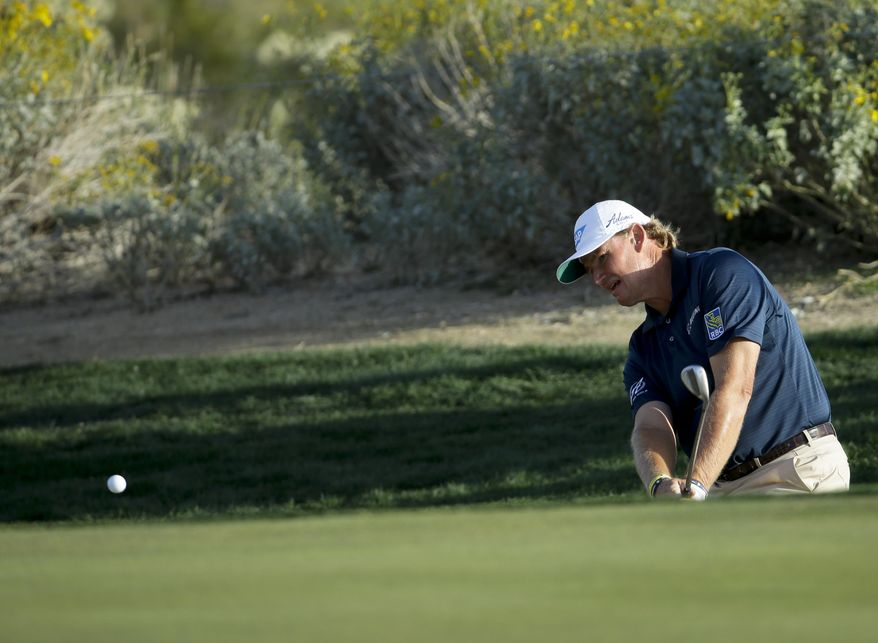 CORRECTS TO 20TH, HOLE, INSTEAD OF 22ND - Ernie Els, of South Africa, watches shot from the rough on the 20th hole in his match against Justin Rose, of England, during the second round of the Match Play Championship golf tournament on Thursday, Feb. 20, 2014, in Marana, Ariz. (AP Photo/Ted S. Warren)