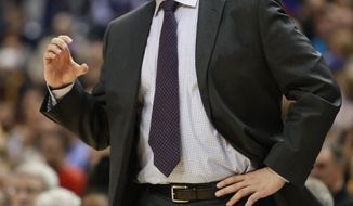Atlanta Hawks coach Mike Budenholzer gestures to his team during the first half of an NBA basketball game against the Indiana Pacers in Indianapolis, Tuesday, Feb. 18, 2014. The Pacers won 108-98. (AP Photo/R Brent Smith)
