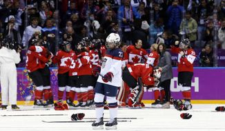 Michelle Picard of the United States (23) skates back to the bench after Canada scored in overtime to win the women's gold medal ice hockey game 3-2 at the 2014 Winter Olympics, Thursday, Feb. 20, 2014, in Sochi, Russia. (AP Photo/Matt Slocum)