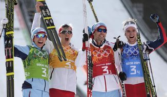 Norway's Haavard Klemetsen, Magnus Krog, Magnus Hovdal Moan and Joergen Graabak, from left, celebrate winning the gold during the cross-country portion of the Nordic combined Gundersen large hill team competition at the 2014 Winter Olympics, Thursday, Feb. 20, 2014, in Krasnaya Polyana, Russia. (AP Photo/Matthias Schrader)