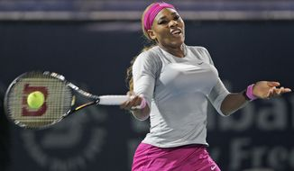 Serena Williams of the U.S. returns the ball to Jelena Jankovic of Serbia during the quarterfinals of the Dubai Duty Free Tennis Championships in Dubai, United Arab Emirates, Thursday, Feb. 20, 2014. (AP Photo/Kamran Jebreili)