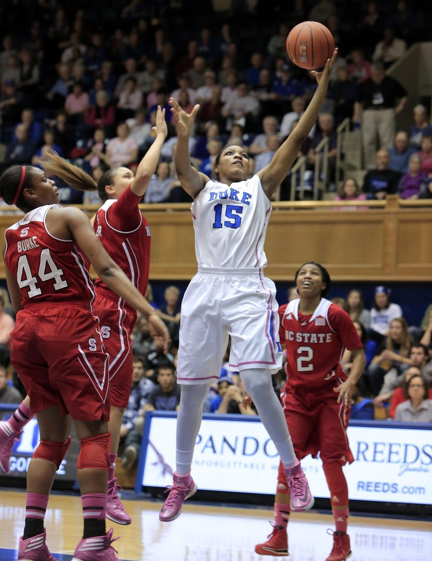 Duke's Richa Jackson shoots near NC State's Kody Burke (44), Len'Nique Brown (2) and Miah Spencer during the first half of an NCAA college basketball game in Durham, N.C., Thursday, Feb. 20, 2014.  (AP Photo/Ted Richardson)