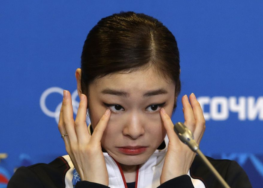 Yuna Kim of South Korea wipes her face as she attends a news conference following the women's free skate figure skating finals at the Iceberg Skating Palace during the 2014 Winter Olympics, Thursday, Feb. 20, 2014, in Sochi, Russia. (AP Photo/Darron Cummings)