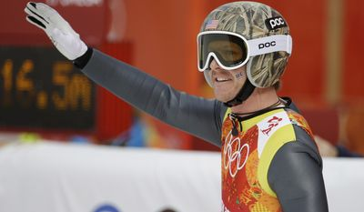 United States' Todd Lodwick waves after his attempt during the ski jumping portion of the Nordic combined Gundersen large hill team competition at the 2014 Winter Olympics, Thursday, Feb. 20, 2014, in Krasnaya Polyana, Russia. (AP Photo/Gregorio Borgia)