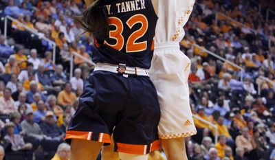 Tennessee forward Cierra Burdick (11) shoots over Auburn forward Tyrese Tanner (32) in the first half of an NCAA college basketball game, Thursday, Feb. 20, 2014, in Knoxville, Tenn. (AP Photo/Wade Payne)