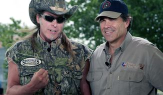 ** FILE ** In this file photo, rock musician Ted Nugent, left, and Texas Gov. Rick Perry, right, speak during an appearance on national television in Crawford, Texas, Saturday, June 4, 2005. Hours after Gov. Rick Perry kicked off his second full term in office on Wednesday, Jan. 17, 2007, rocker Ted Nugent helped him celebrate at a black-tie gala, but not all attendees were pleased by the performance. Using machine guns as props, Nugent appeared onstage as the final act of the inaugural ball wearing a cut-off T-shirt emblazoned with the Confederate flag and shouting offensive remarks about non-English speakers, according to people who were in attendance. (AP Photo)