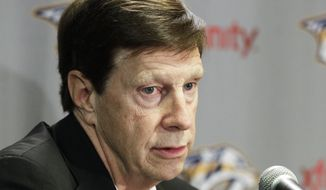 **FILE** Nashville Predators general manager David Poile answers questions at a news conference on Wednesday, March 21, 2012, in Nashville, Tenn. (AP Photo/Mark Humphrey)
