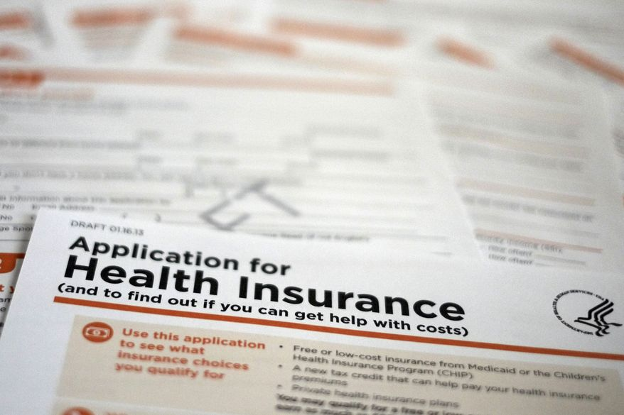 **FILE** A draft copy of the 21-page Health and Human Services Department form proposed for use to apply for low-cost insurance from Medicaid or the Children's Health Insurance Program is photographed in Washington on March 12, 2013. (Associated Press)