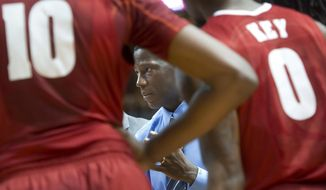 Alabama coach Anthony Grant speaks to his team during a timeout during the second half of an NCAA college basketball game against Texas A&M at Reed Arena in College Station, Texas, Thursday, Feb. 20, 2014. (AP Photo/Bryan College Station Eagle, Stuart Villanueva)