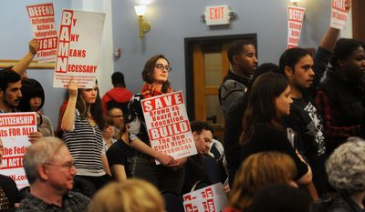Members of By Any Means Necessary, a civil rights activist group, protest during a Board of Regents meeting Thursday, February 20 at the Michigan Union in Ann Arbor, Mich. (AP Photo/The Ann Arbor News, Brianne Bowen)