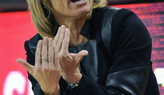 Florida State head coach Sue Semrau instructs her team in the first half of an NCAA college basketball game against Maryland Thursday, Feb. 20, 2014, in College Park, Md. (AP Photo/Gail Burton)