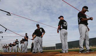 Chicago White Sox pitchers stretch during spring training baseball practice in Glendale, Ariz., Wednesday, Feb. 19, 2014. (AP Photo/Paul Sancya)