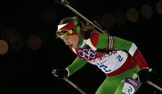 Belarus' Darya Domracheva races to win the gold medal in the women's biathlon 12.5k mass-start, at the 2014 Winter Olympics, Monday, Feb. 17, 2014, in Krasnaya Polyana, Russia. (AP Photo/Felipe Dana)