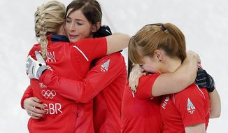 Britain's women's curling team from left to right, Anna Sloan, Eve Muirhead, Vicki Adams and Claire Hamilton, celebrate after beating Switzerland in the women's curling bronze medal game at the 2014 Winter Olympics, Thursday, Feb. 20, 2014, in Sochi, Russia. (AP Photo/Wong Maye-E)