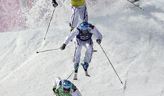 Jean Frederic Chapuis of France, bottom, leads compatriots Arnaud Bovolenta, and Jonathan Midol, as Canada's Brady Leman crashes behind them in the men's ski cross final at the Rosa Khutor Extreme Park, at the 2014 Winter Olympics, Thursday, Feb. 20, 2014, in Krasnaya Polyana, Russia. (AP Photo/Andy Wong)