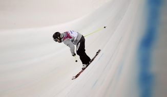 Bronze medalist Japan's Ayana Onozuka skis in her final run in the women's ski halfpipe competition at the Rosa Khutor Extreme Part, at the 2014 Winter Olympics, Thursday, Feb. 20, 2014, in Krasnaya Polyana, Russia. (AP Photo/Charlie Riedel)