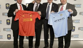 Robbie Fowler, representing the Liverpool Football Club, left, Charlie Stillitano, CEO of Relevent Sports, second from left, Mike Summerbee, representing the Manchester City Football Club, second from right, and Mark Holtzman with the New York Yankees pose for a picture after a news conference in New York, Thursday, Feb. 20, 2014. Manchester City and Liverpool will play one another at Yankee Stadium as part of the International Champions Cup on July 30, 2014. (AP Photo/Seth Wenig)
