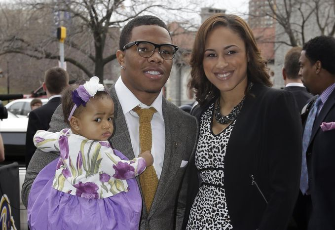 FILE - In this March 11, 2013 file photo, Baltimore Ravens running back Ray Rice, left, poses with his daughter, Rayven, and Janay Palmer as they arrive for a screening of a new film released on DVD that chronicles the team's championship NFL football season in Baltimore. A police complaint alleges Rice knocked out Palmer, his fiancee, during an argument at an Atlantic City, N.J., casino. Police charged both Rice and J Palmer with simple assault in the incident Saturday, Feb. 16, at the Revel Casino. (AP Photo/Patrick Semansky, File)