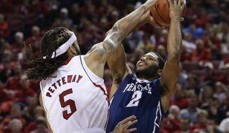 Penn State's D.J. Newbill (2) shoots over Nebraska's Terran Petteway (5) in the first half of an NCAA college basketball game in Lincoln, Neb., Thursday, Feb. 20, 2014. (AP Photo/Nati Harnik)