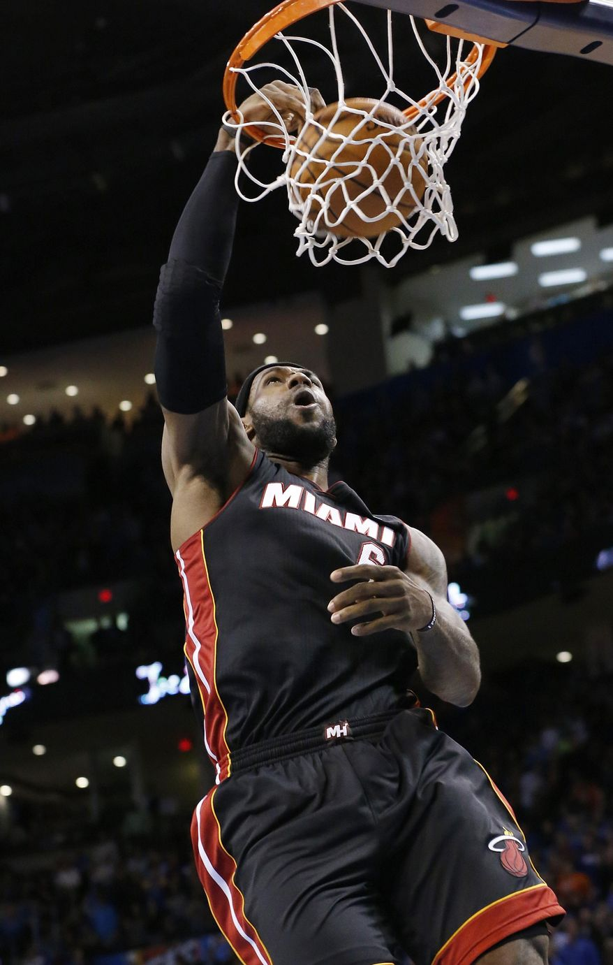 Miami Heat forward LeBron James (6) dunks during the first quarter of an NBA basketball game against the Oklahoma City Thunder in Oklahoma City, Thursday, Feb. 20, 2014. (AP Photo/Sue Ogrocki)