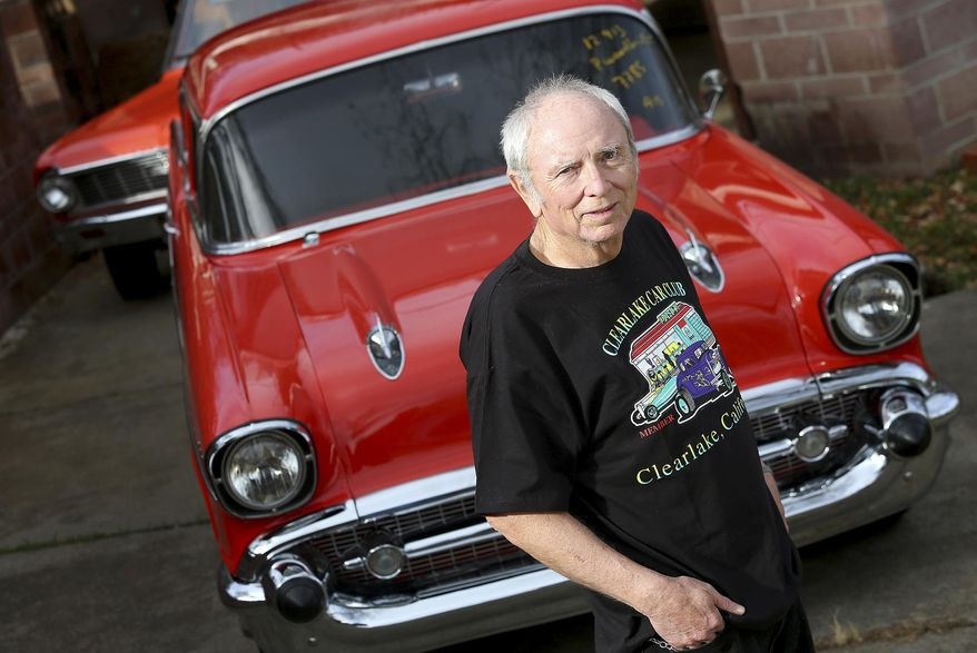"""In this Tuesday, February 18, 2014 photo, Skip Wilson poses in front of his 1957 Chevrolet Bel Air that was stolen in 1984 and returned to him by the California Highway Patrol on Monday, February 17, in Clearlake Oaks, Calif. Three decades after it was stolen, a 1957 Chevrolet Bel Air has been returned to a Northern California man,  in better shape than when he originally owned it. The Santa Rosa Press Democrat reports Ian """"Skip"""" Wilson was shocked to get a call from the California Highway Patrol informing him that his long-lost prized Chevy was taken off an Australia-bound cargo ship. (AP Photo/Santa Rosa Press Democrat, Christopher Chung)"""