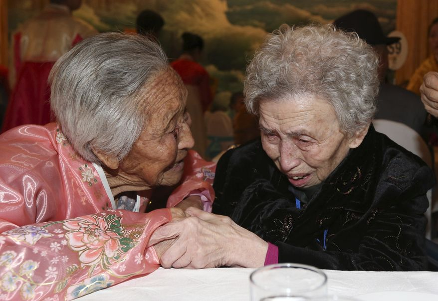 South Korean Lee Young-shil, 87, right, meets with her North Korean sister Lee Jong Shil, 84, during the Separated Family Reunion Meeting at Diamond Mountain resort in North Korea, Thursday, Feb. 20, 2014. Elderly North and South Koreans separated for six decades are tearfully reuniting, grateful to embrace children, brothers, sisters and spouses they had thought they might never see again. (AP Photo/Yonhap, Lee Ji-eun)