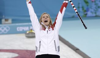 Canada's skip Jennifer Jones celebrates after delivering the last rock to defeat Sweden in the women's curling gold medal game at the 2014 Winter Olympics, Thursday, Feb. 20, 2014, in Sochi, Russia. (AP Photo/Robert F. Bukaty)