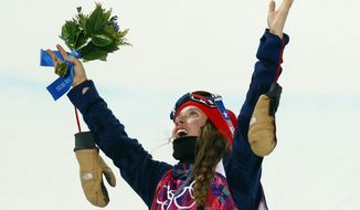 Maddie Bowman of the United States celebrates after winning the gold medal in the women's ski halfpipe final at the Rosa Khutor Extreme Park, at the 2014 Winter Olympics, Thursday, Feb. 20, 2014, in Krasnaya Polyana, Russia.(AP Photo/Sergei Grits)