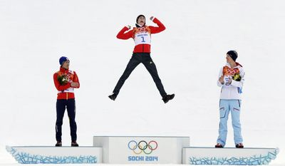 Germany's Eric Frenzel celebrates winning the gold as he is flanked by Japan's silver medal winner Akito Watabe, left, and Norway's bronze medal winner Magnus Krog during the flower ceremony after the cross-country portion of the nordic combined at the 2014 Winter Olympics, Wednesday, Feb. 12, 2014, in Krasnaya Polyana, Russia. (AP Photo/Matthias Schrader, File)