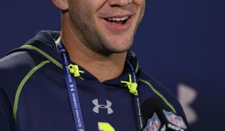Central Florida quarterback Blake Bortles answers a question during a news conference at the NFL football scouting combine in Indianapolis, Friday, Feb. 21, 2014. (AP Photo/Michael Conroy)