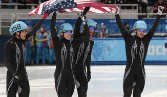 From left, J.R. Celski of the United States, Jordan Malone of the United States, Chris Creveling of the United States and Eduardo Alvarez of the United States celebrate their second place in the men's 5000m short track speedskating relay final at the Iceberg Skating Palace during the 2014 Winter Olympics, Friday, Feb. 21, 2014, in Sochi, Russia. (AP Photo/Ivan Sekretarev)