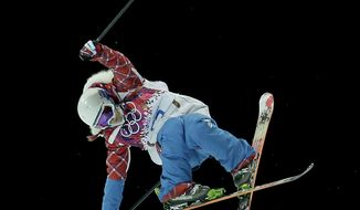 Silver medalist France's Marie Martinod competes in the women's ski halfpipe finals at the Rosa Khutor Extreme Park, at the 2014 Winter Olympics, Thursday, Feb. 20, 2014, in Krasnaya Polyana, Russia. (AP Photo/Charlie Riedel)