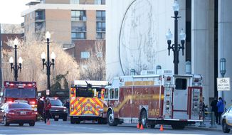 Salt Lake City Fire and Police Department vehicles in position outside the Church of Jesus Christ of Latter-day Saints building in downtown Salt Lake City, Utah Friday, Feb. 21, 2014 after white powder was found in an envelope inside the building.  Fire officials say four people who were exposed to the powder are being evaluated at a hospital. They were also put through a decontamination process. It's unclear if the powder is toxic. (AP Photo/The Salt Lake Tribune, Steve Griffin)