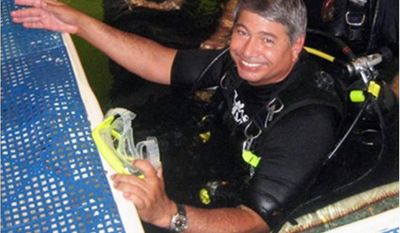 This photo provided by Roane State Community College shows, Bruce Cantrell, a professor of biology at Roane State Community College in Tennessee,  who has spent nearly 200 hours in the underwater habitat in Key Largo. (AP Photo/Roane State Community College)
