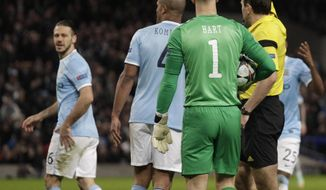 Manchester City's Martin Demichelis is shown a red card by referee Jonas Eriksson during their Champions League first knock out round soccer match at the Etihad Stadium, Manchester, England, Tuesday Feb. 18, 2014. (AP Photo/Jon Super)