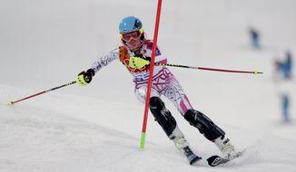 Lebanon's Jacky Chamoun skis in the first run of the women's slalom at the Sochi 2014 Winter Olympics, Friday, Feb. 21, 2014, in Krasnaya Polyana, Russia. (AP Photo/Charles Krupa)