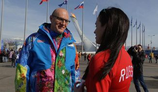 Sochi 2014 Organizing Committee President Dmitry Chernyshenko, left, talks to a Russian fan during a tour of Olympic Park at the 2014 Winter Olympics, in Sochi, Russia on Thursday, Feb. 20, 2014. (AP Photo/Ben Jary)