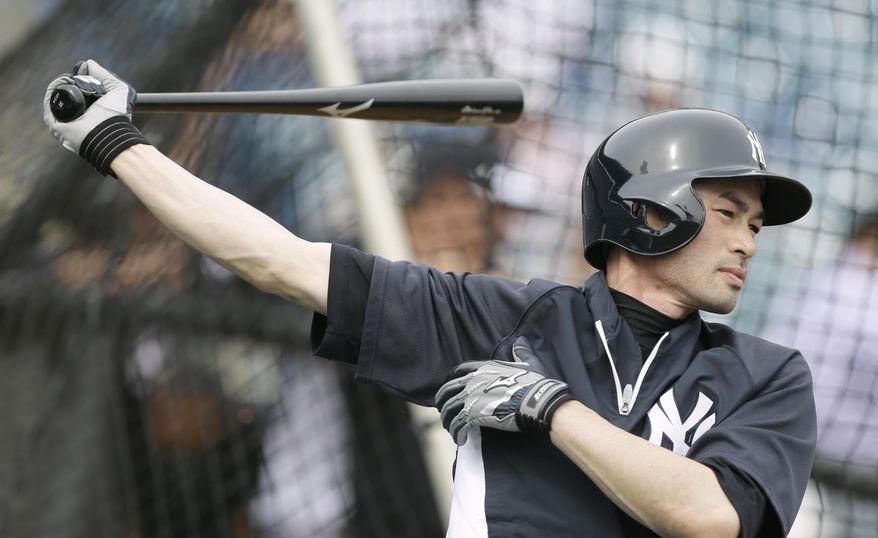 New York Yankees right fielder Ichiro Suzuki waits to hit in the batting cage during spring training baseball practice Friday, Feb. 21, 2014, in Tampa, Fla. (AP Photo/Charlie Neibergall)
