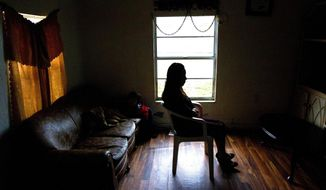 In this Jan. 29, 2014 photo, Mely Perez speaks about her experience as a farmworker at her home in Immokalee, Fla. (AP Photo/The News-Press, Kinfay Moroti)  MAGS OUT; NAPLES OUT;  NO SALES