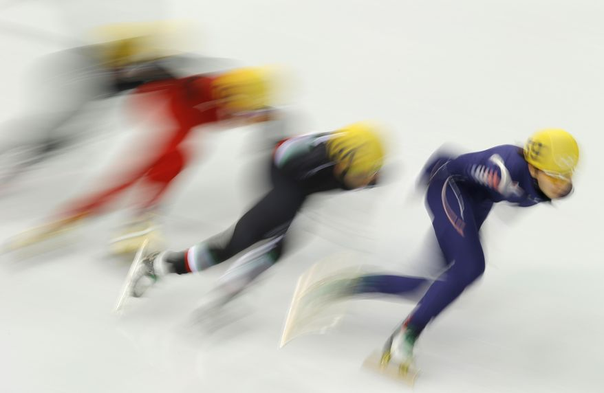 From right, Shim Suk-Hee of South Korea, Arianna Fontana of Italy, Fan Kexin of China and Emily Scott of the United States compete in a women's 1000m short track speedskating quarterfinal at the Iceberg Skating Palace during the 2014 Winter Olympics, Friday, Feb. 21, 2014, in Sochi, Russia. (AP Photo/Vadim Ghirda)