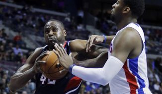 Atlanta Hawks forward Elton Brand (42) drives to the basket against Detroit Pistons center Andre Drummond, right, during the first half of an NBA basketball game Friday, Feb. 21, 2014, in Auburn Hills, Mich. (AP Photo/Duane Burleson)