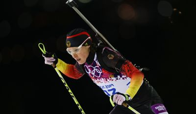 "FILE - In this Feb. 17, 2014 file photo, Germany's Evi Sachenbacher-Stehle skis during the women's biathlon 12.5k mass-start, at the 2014 Winter Olympics,  in Krasnaya Polyana, Russia. German Olympic officials said Sachenbacher-Stehle has been kicked out of the Sochi Games after a positive doping test. The German Olympic Committee said she tested positive on Monday, Feb. Feb. 17, for the stimulant methylhexanamine. Both the ""A'' sample and backup ""B'' sample were positive. The committee said the athlete has been removed from the team and is being sent home. (AP Photo/Felipe Dana, File)"