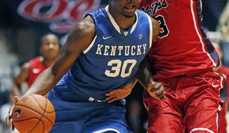 Kentucky forward Julius Randle (30) dribbles up court against Mississippi forward Anthony Perez (13) during the second half of an NCAA college basketball game in Oxford, Miss., Tuesday, Feb. 18, 2014. Kentucky won 84-70. (AP Photo/Rogelio V. Solis)